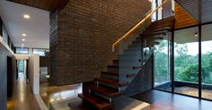 Hill House | KO & Co Architecture  Floating glass and timber stair with brick support wall