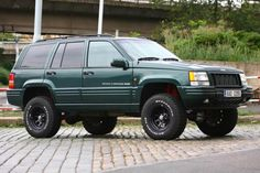 The Ten Best Jeeps Ever Made - 6. Grand Cherokee ZJ. I think they put ZJs too low on the scale... This one is a European version (ZG) 5.9L LX