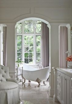Look close at the floor tile work.  That's what makes it elegant.  The silver-leaf legs on the tub and shear curtains.