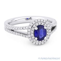 The featured ring is cast in 18k white gold and showcases an oval blue sapphire center gem accentuated by round cut diamonds all the way around the double-halo design and halfway along the splitshank bands.