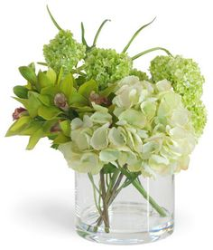 Really nice, simple arrangements.  You can do this yourself.  In this photo:  Green Cymbidium Orchid and Hydrangea Arrangement contemporary plants