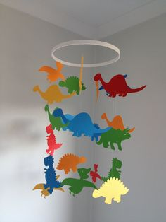 Paper dinosaur hanging mobile. $30.00, via Etsy.