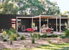 A Modular Beachside Getaway in Australia Putting her architectural training to work, a resident of Merricks, Australia, helps design a modular beachside getaway for her family. Photo by Lisa Cohen. Wicker Swing, Swing Chairs, Hanging Chairs, Architect House, Architect Design, Outdoor Lounge, Outdoor Spaces, Cap Ferret, Lisa Cohen
