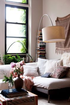 I love this Bohemian interior design and this room is a beautiful part of a bohemian home decor theme. I love the bold colors mixed in with ecletic bohemian wall art and Bohemian decorative accents. A Gallery of Bohemian Bedroom #BohemianDecor #ModernBohemianDecor