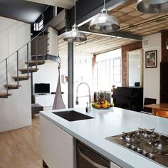 My dream kitchen: the perfect combination of old and new. Exposed brick and industrial style lighting combined with a contemporary, gloss finish island and rustic dining room table gives a homely feel that I love about this kitchen.