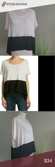 """NWT! Free People Oversized Short Sleeve Tee Shirt This 'Midnight' tee features a boat neckline, dolman-style short sleeves, furled trim, and a high-low hemline. Oversized for maximum comfort! Material: 60% cotton/40% modal                  (machine wash cold) Measurements: Approx 24""""W (pit-to-pit)            Approx 22""""L (front)/28.5""""L (back)                       shoulder to hem Color:. Black and white Free People Tops Tees - Short Sleeve"""