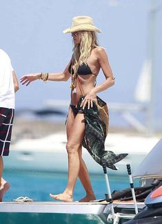 Google Image Result for http://lamodellamafia.com/wp-content/uploads/2012/07/la-modella-mafia-Elle-Macpherson-Summer-2012-beach-style-over-accessorized-with-a-cowboy-hat-aviator-sunglasses-and-boho-jewelry-1.jpg