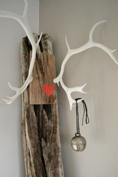 LOVE this, antlers on old wood