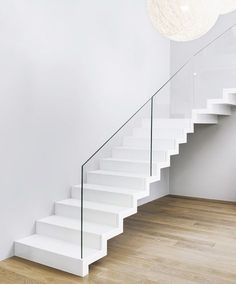 />Zigzag stair made of white painted oak. Balustrade made of glass. Private residential project, designed by TRĄBCZYŃSKI. White Staircase, Staircase Runner, Staircase Design, Open Stairs, Floating Stairs, Stair Gallery, Stair Lighting, White Oak Floors, Interior Stairs
