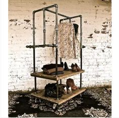 American vintage clothing store shelf floor , wrought iron coat rack hangers do the old pipes clothing display