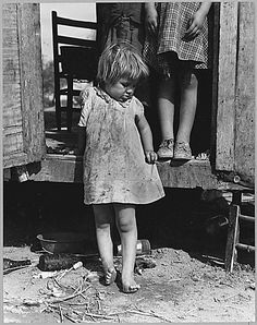 """On Arizona Highway 87, south of  Chandler. Maricopa County, Arizona. Children in a democracy. A  migratory family living in a trailer in an open field. No sanitation, no  water. They came from Amarillo, Texas. Pulled bolls near Amarillo,  picked cotton near Roswell, New Mexico, and in Arizona. Plan to return  to Amarillo at close of cotton picking season for work on WPA.  11/1940"" Dorothea Lange"
