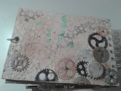 Back cover, layers of paper, paint and paste. Cigs and metal brads and elements.