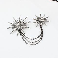 Elegantná prepracovaná brošňa v tvare hviezd s kryštálikmi
