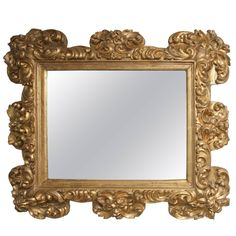 "Italian Baroque Carved Giltwood Mirror, circa 1700  37""h 46w 