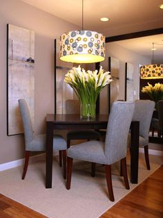 "Leave Roughly 30 Inches Between Table and Bottom of Fixture  ""That ensures that the chandelier doesn't encroach on your view of dining companions and leaves space to fit a vase of flowers or another tall centerpiece,"" designer Karl Lohnes says. ""Most people hang chandeliers way too high."" Design by Christopher J. Grubb."