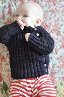 I designed this sweater to grow with my daughter. In the pattern pictures you can see her modeling it at four and a half months, seven months, and almost nine months. Her friend C modeled the same sweater when she was ten months old.