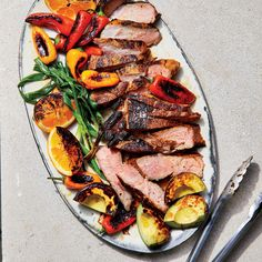 This Mojo Pork Steak with Seared Avocados and Oranges is grilled a la plancha, or on the griddle, for juicy, tender meat and an even, all-over char. Get the recipe at Food & Wine. Grilled Steak Recipes, Pork Recipes, Wine Recipes, Healthy Recipes, Avocado Recipes, Healthy Eats, Entree Recipes, Grilling Recipes, Cooking Recipes