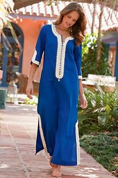 A caftan dress is a full-length, loose garment with elbow-length or long sleeves, worn chiefly in eastern Mediterranean countries midlife chic/ style/ fashion Arab Fashion, African Fashion, Indian Fashion, Fashion Women, Sleepwear Women, Pajamas Women, Sari, Moroccan Caftan, Moda Boho