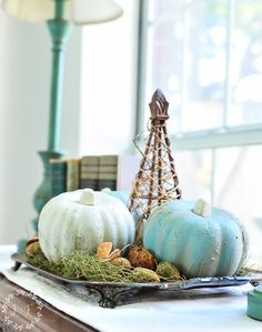 DIY Dollar Store weathered texture pumpkins. With a little fresco and some dabs of paint, your fall decor can get a cheap upgrade!