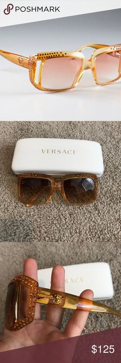 Versace sunglasses In good condition. All amber crystals are intact. Glasses and case are authentic. Beautiful statement piece Versace Accessories Sunglasses