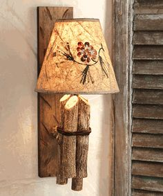 Twig Rustic Wall Lamp: A bundle of tied bark-on twigs and a hand-painted pinecone shade on a wood base give this lamp a quintessential lodge lighting style. Rustic Wall Sconces, Rustic Lamps, Wood Lamps, Adirondack Decor, Country Lamps, Wall Lamp Shades, Wooden Lampshade, Fabric Lampshade, Black Forest Decor
