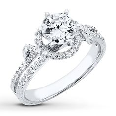 Round diamonds swirl romantically together to create a striking engagement ring.