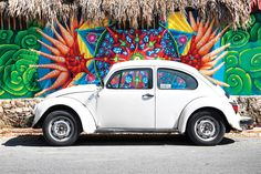 White VW Beetle Car In Cancun by Philippe Hugonnard is printed with premium inks for brilliant color and then hand-stretched over museum quality stretcher bars. 60-Day Money Back Guarantee AND Free Return Shipping.