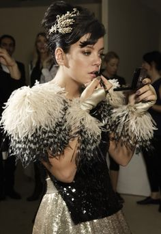 adorned in head (wheat sheaf pin) to nails in Chanel. just adore Lily Allen.
