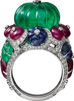 """CARTIER. """"Rajasthan"""" Ring - platinum, one 20.44-carat carved emerald bead from Afghanistan, ruby beads, melon-cut sapphire beads, carved rubies, sapphires and emeralds, brilliant-cut diamonds. #Cartier #CartierMagicien #HauteJoaillerie #HighJewellery #FineJewelry #CarvedStones #TuttiFrutti #Emeralds #Rubies #Sapphires #Diamonds"""