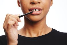 Gap teeth are currently en vogue, and getting the look for your costume only requires one product — eyeliner!  First, you want to clean off your teeth with alcohol and suck in a good amount of air to dry off the surface. Apply a black gel eyeliner or a waterproof pencil to the front two teeth.