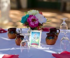 loteria table seating chart and mexican wedding decor used mexican clay ollitas mugs