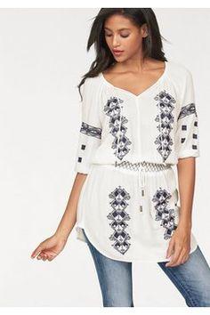 Lange blouse met borduursel