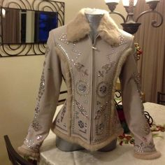 HP X3 Leather Swarovski Crystal Coat HP 11/1/14 HP12/5/14 HP12/8/14 100% GENUINE LEATHER CRIPPLE CREEK COAT with SWAVORSKI CRYSTAL DESIGN ALL OVER THE OUTSIDE OF COAT! Fur collar! Fur trim sleeves and bottom of coat, Fur design in front and back of coat! Lining is 100% polyester. This coat has been worn only once! It has been professionally stored! Size Small. This is truly a beautiful coat!!! CRIPPLE CREEK Jackets & Coats