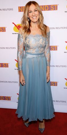 Sarah Jessica Parker inadvertently channeled a Disney princess at the 42nd Street 25th Anniversary Gala, gracing the red carpet in an icy blue off-the-shoulder Reem Acra lace chiffon dress that drew comparisons with Elsa from Frozen. But of course SJP gave it her signature spin—she styled the dress with chandelier earrings and glittery pumps.