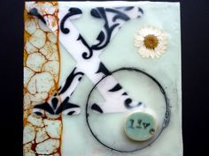 encaustic and mixed media painting (beeswax, resin, pigment, pressed daisy, ceramics, paper, oil stick, wood shellac, to name a few...)