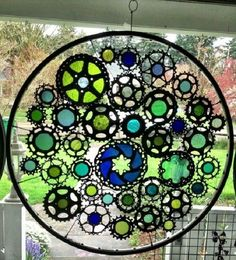 Bicycle tire rim with gears and stained glass