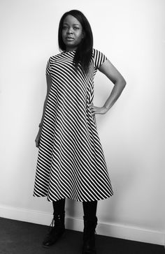 Bo wears a UK size 10 Groove dress, with a straight hem, slash neck and short sleeves.