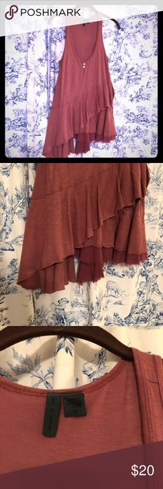 Anthropologie tank...super cute Anthropologie tank Size XS but will fit up to a medium or a small large... I am listing shirt as a Medium do to this...  Brand: left of center  Beautiful rust color Anthropologie Tops Tank Tops