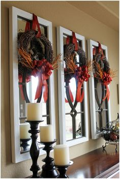 Love the mirrors over the sideboard with the fall wreaths hanging from them.