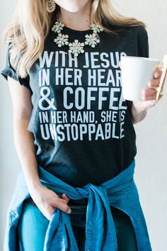 with jesus in her heart and coffee in her hand she is unstoppable triblend tee charcoal karla storey