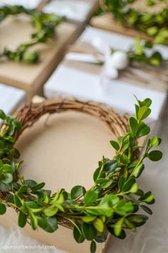 Mini boxwood wreaths make the perfect toppers for holiday gifts this year.