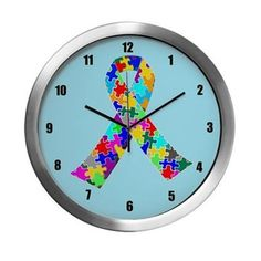 $40 Autism Ribbon Modern Wall Clock. Pretty blue clock with autism puzzle pieces in rainbow and primary colors to represent the autistic spectrum. Great gift.