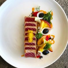 AHI/ soy and sugar nectarines/ mirin onions/ squid ink and orange aioli/ wakami and cilantro/ lemon tobiko . Seafood Appetizers, Seafood Recipes, Gourmet Recipes, Cooking Recipes, Food Garnishes, International Recipes, Creative Food, Food Presentation, Food Plating