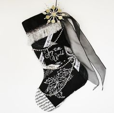 Black and white Christmas stocking, a custom handmade one-of-a-kind holiday decoration on Etsy, $75.00