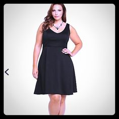 Torrid Skater Dress Textured to the touch, this skater dress will make heads turn. The fitted bodice has arched seams that will flatter your curves; the spin-worthy skirt is loose and flowy (perfect for dancing). A scoop back meets a v-neck front.    Size 2 (18/20) Fabric: Polyester/spandex - Wash cold, dry flat torrid Dresses