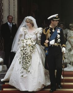 July Prince Charles marries Lady Diana Spencer in Saint Paul's Cathedral. The gown Diana wore had a 25 foot train and incorporated pearls, lace and embroidery. Charles and Diana divorced on 28 August Celebrity Wedding Photos, Celebrity Wedding Dresses, Celebrity Weddings, Wedding Gowns, Wedding Ceremony, Wedding Bouquets, Bridal Gown, Royal Wedding Dresses, 1980s Wedding Dress