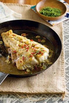 Roast Cod with a Hot Garlic & Chile Dressing. This didn't turn out well. It tasted ok but didn't stay in one piece or even a couple and we can't seem to get rid of the fish smell in our house and it's been over a week. I have had better fish recipes.