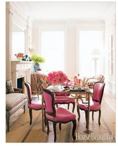 House Beautiful.  Love the shocking hot pink, nailhead, french inspired chairs. A man clearly lives here. Clearly.. The hot pink chairs add so much interest into the dining/sitting room.