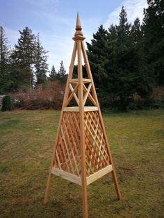Bespoke design solid red cedar obelisk with combination trellis and criss cross design. Contact us with your design ideas.