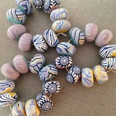 A set of 10 disk beads in spirals, floral and graphic patterns. This set contains 5 matching pairs of beads. Inspired by the Art Bead Scenes monthly